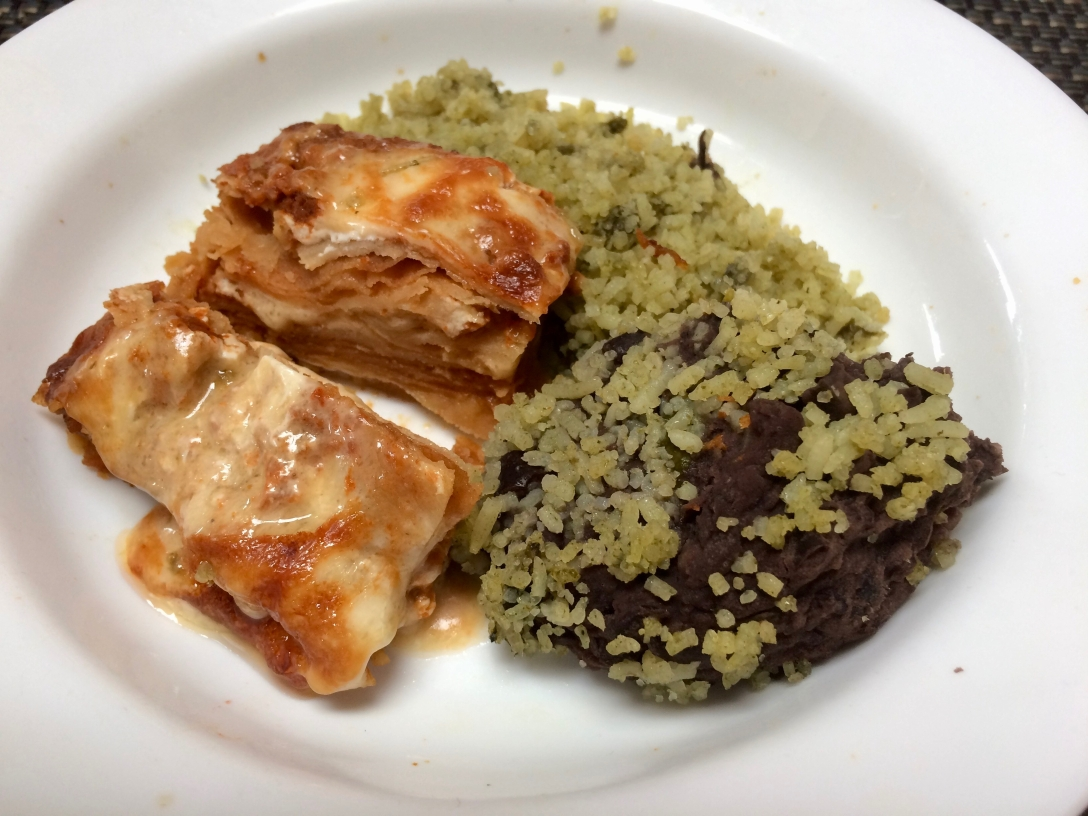 Mata G's Enchilada with green rice and black beans